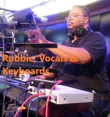 Robbie - Vocals and Keyboard